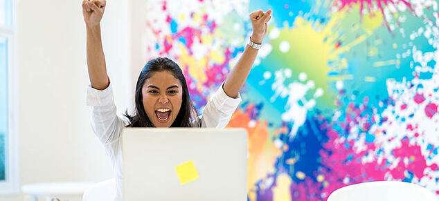 Excited Employee_Color Splotch Background_GettyImages_980x450
