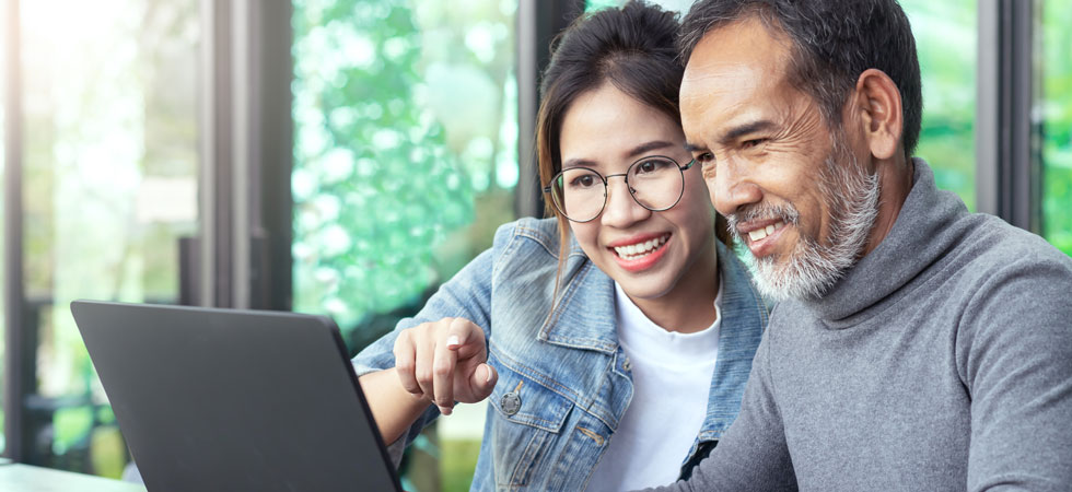 Father and daughter on computer together