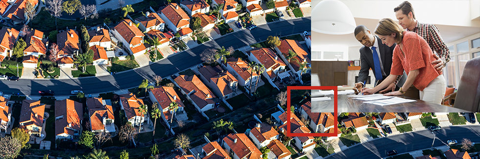 Arial shot of suburbs with an overlay of 3 people signing paperwork on a desk