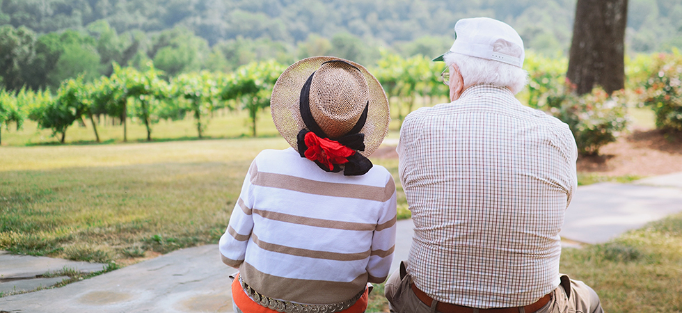 Senior couple looking out into a field