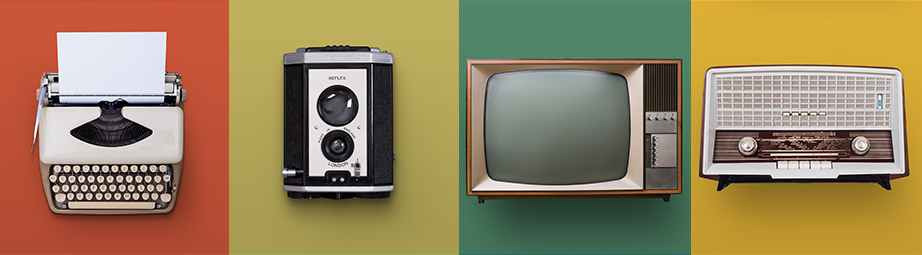 retro typewriter, camera, television, and stereo with red, yellow, green, and orange background