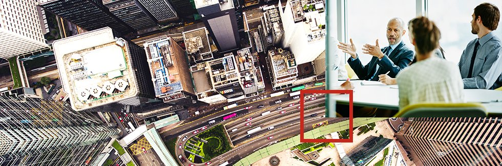 Arial shot of a city with an overlay image of 4 business colleagues chatting