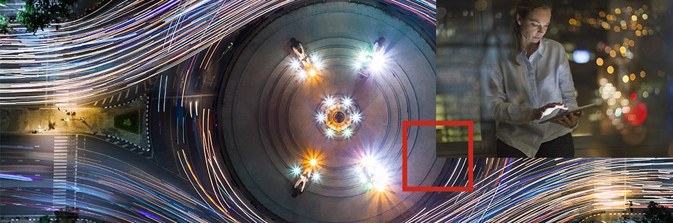 Arial shot of a time-lapsed roundabout with an overlay of a business woman on a smart tablet