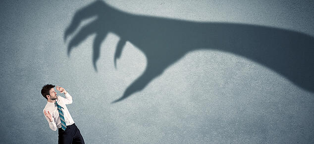 Man Scared of Shadow Clawed Hand_GettyImages_980x450